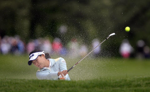 Ilhee Lee shoots out of a bunker on the front 9 during the final round of the LPGA Kingsmill Championship on Sunday, May 5.
