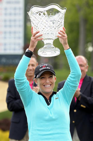 Cristie Kerr hold up the Kingsmill Championship trophy Sunday in Williamsburg after taking two play-off holes to beat Suzann Pettersen.