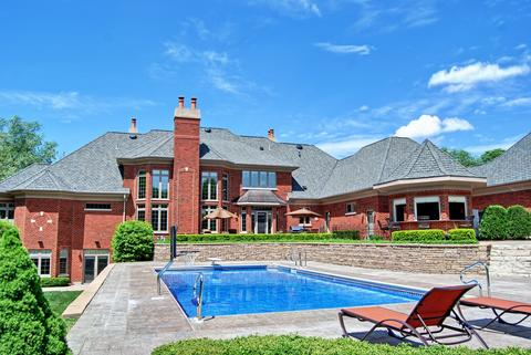 Price: $1,999,900. Square footage: 10,000. Year built: 2006. Amenities: In-ground pool, movie theater, 10-car garage. Extras: Full indoor basketball court.