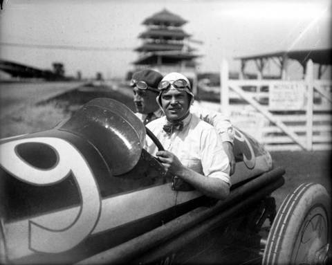 Race car driver Frank Elliott at the 1922 Indianapolis 500. Elliott competed six times at Indy. The racetracks famous pagoda, built in 1913, can be seen in the background.