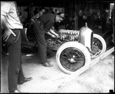 """Millionaire race car driver Russell """"Cliff"""" Durant works on his Durant Special in the garage. Durant was the son of William C. Durant, the founder of General Motors. Durant competed in six Indianapolis 500 races from 1919 to 1928."""