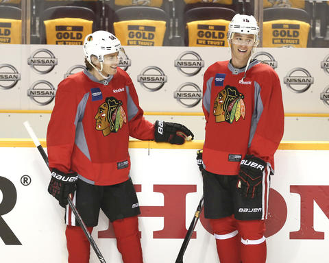 Patrick Kane, left, and Jonathan Toews smile during a morning skate before the Blackhawks' series against the Predators.