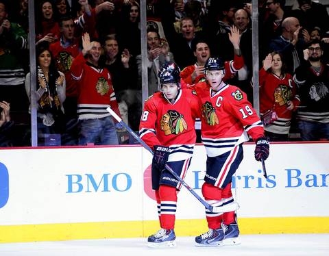 Blackhawks center Jonathan Toews (19) reacts with right wing Patrick Kane after scoring a goal against Columbus on March 6, 2014.