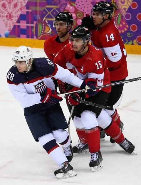 Team USA forward Patrick Kane (88) and Canada forward Jonathan Toews (16) battle in the third period of a men's hockey semifinal at the Winter Olympics in Sochi, Russia,