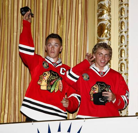 Jonathan Toews and Patrick Kane toss hats to fans at the inaugural Chicago Blackhawks Convention at the Hilton & Towers in Chicago on July 18, 2008.