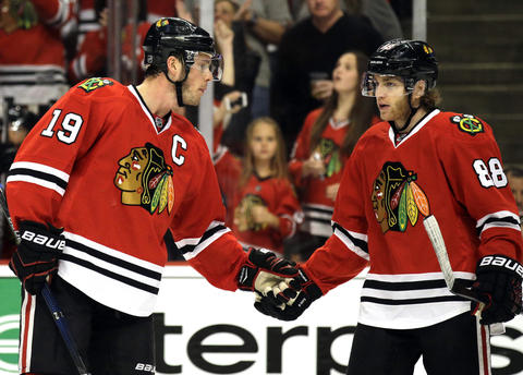 Jonathan Toews, left, celebrates with Patrick Kane after scoring a goal during the first period in Game 6 against the Predators.