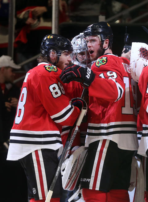 Patrick Kane, Corey Crawford and Jonathan Toews celebrate their 5-4 win over the Los Angeles Kings in the second overtime period in Game 5 of the Western Conference Final.