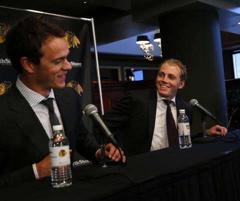 Jonathan Toews and Patrick Kane speak during a press conference announcing their new contracts.