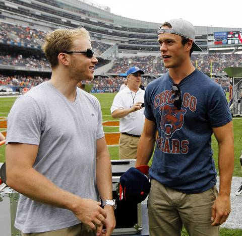 Patrick Kane and Jonathan Toews talk before the Bears game on Sept. 8, 2013 at Soldier Field.