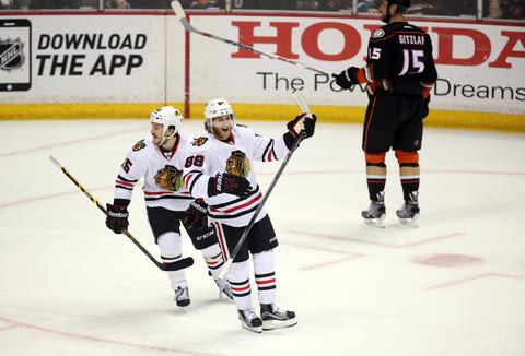 Patrick Kane celebrates Jonathan Toews' second goal in the first period of Game 7 in the Western Conference Final.