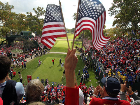 Bubba Watson, a member of the U.S. team, signals that his drive is going right after teeing off on the first hole during a Ryder Cup singles match at Medinah Country Club in 2012.