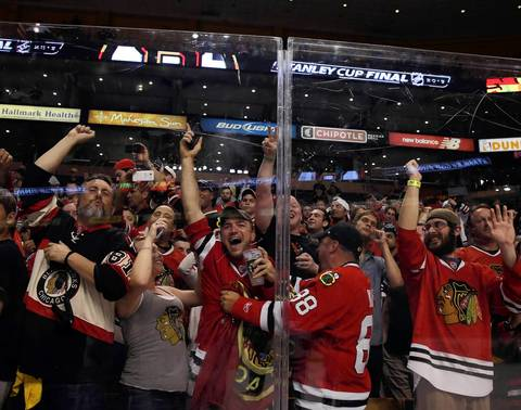 Chicago Blackhawks fans celebrate after Game 6 of the 2013 Stanley Cup Final at TD Garden in Boston.