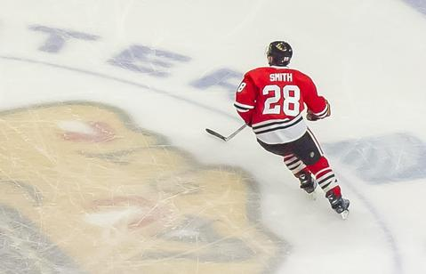 Blackhawks right wing Ben Smith skates the United Center ice