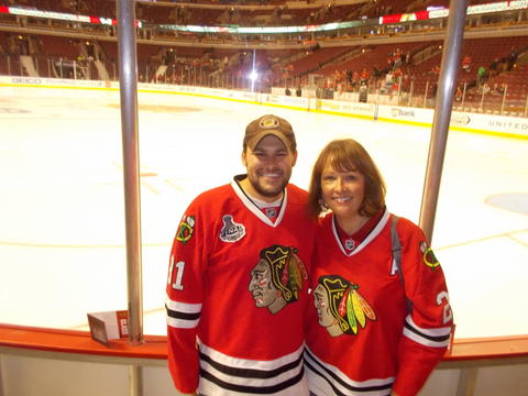 Rosemary Troxel, Lake Forest, and son, Kirk, cheer on the Blackhawks at the game against Ottawa on October 29.