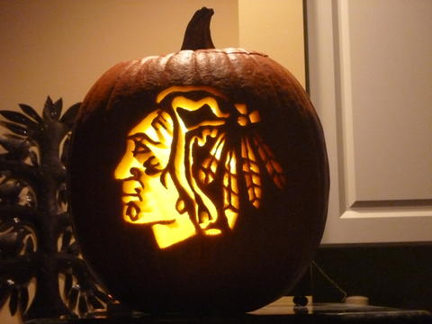 Opponents better be scared when you see the Indian Head. Mark Strauss celebrates a recent win with a new pumpkin.