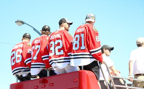 Apparently, if you take a closer look, some team members have signed the back of Hossa's jersey.