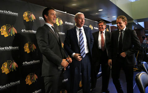 Jonathan Toews and Patrick Kane have a laugh with Blackhawks president and CEO John McDonough and Blackhawks owner Rocky Wirtz after a press conference announcing their new contracts.
