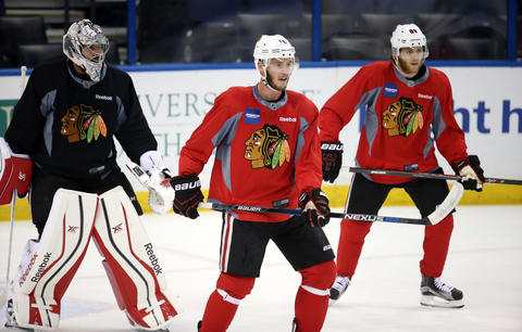Corey Crawford, Jonathan Toews and Patrick Kane during practice before the Stanley Cup Final.