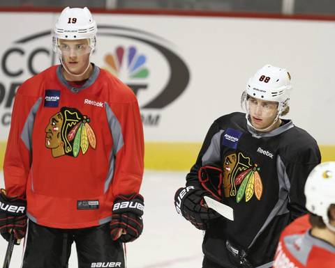 Jonathan Toews (left) and Patrick Kane prepare for their first regular-season game of the 2012-13 season on Jan. 17, 2013, after the NHL lockout.