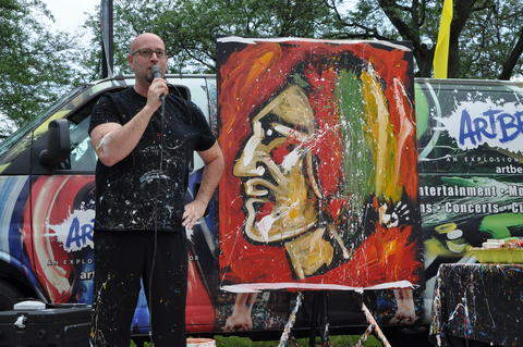 "Artist Elliott From stands next to his ""performance art"" creation at the Cantigny Fine Art Festival on June 20."