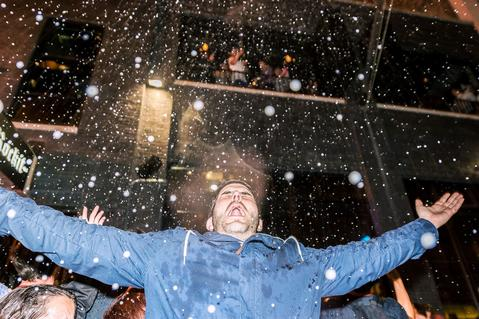 Blackhawks fan Joe Ptak celebrates the 2015 Stanley Cup win in a champagne shower outside Rockit in River North on Tuesday, June 16th. Photo by Maria Evans