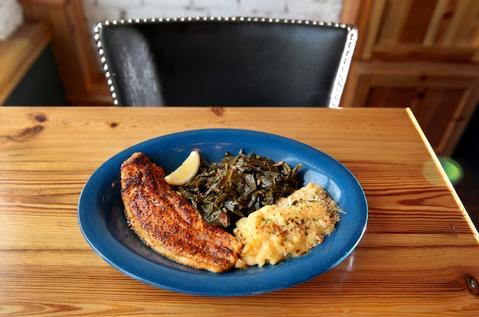 Blackened catfish with greens and macaroni and cheese, at Pearl's Southern Comfort, 5352 N. Broadway St. in Edgewater