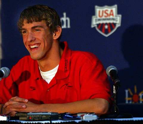 Michael Phelps is all smiles as he speaks during a press conference during U.S. Olympic swimming media day.