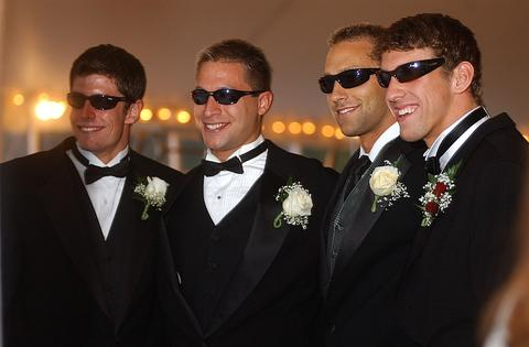 Swimmers (from left) James Barone, Dominic Szabo, Kevin Clements and Michael Phelps sport sunglasses and tuxedos at the North Baltimore Aquatic Club's 2004 gala and fundraiser.