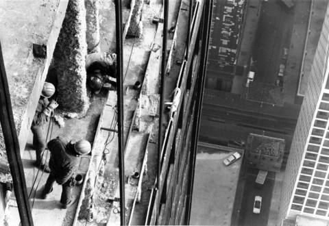 Workers take in the view from the 80th floor of the Sears Tower under construction in November 1972.