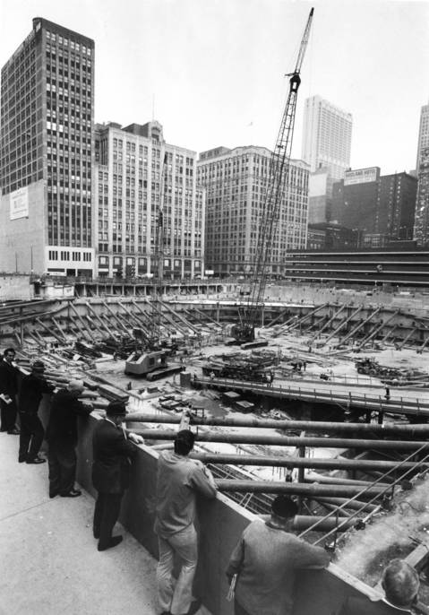Passers-by watch construction begin at the site of the future Sears Tower in June 1971 in downtown Chicago. Upon completion, the tower was the tallest in the world.