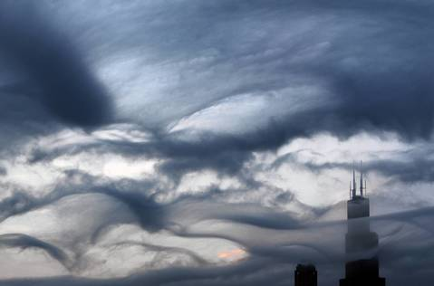 The Willis Tower is bathed in clouds before a 2012 spring storm in Chicago.