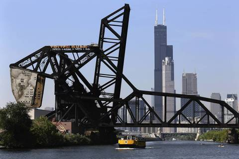 Willis Tower, the world's tallest for many years, looms over the Chicago River's South Branch.