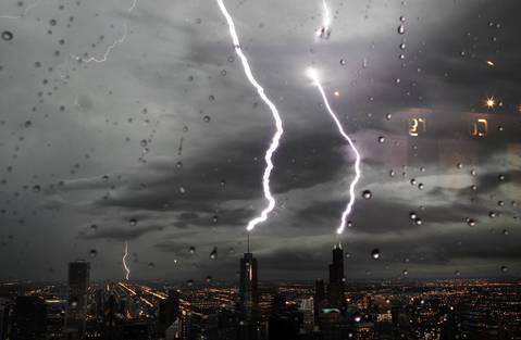 Lighting strikes both the Willis Tower and the Trump Tower in downtown Chicago as a severe storm rolls through the region in June 2010.