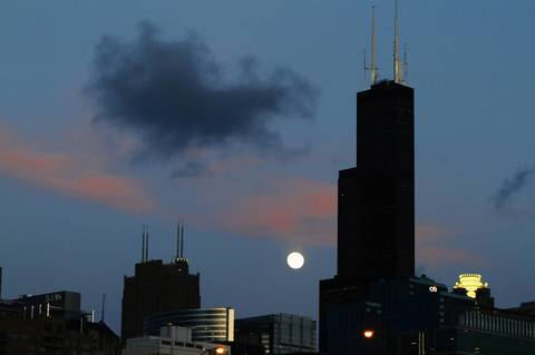 The Willis Tower, the moon and pink clouds make for a beautiful sunset in Chicago in 2011.