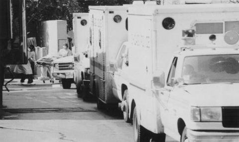 Chicago police vehicles transporting victims of the heat wave in line at the Cook County medical examiner's office on July 17, 1995.