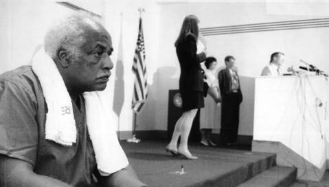 Lucius Robinson, a worker at the morgue, takes a break during a July 17, 1995, news conference at the Cook County facility.