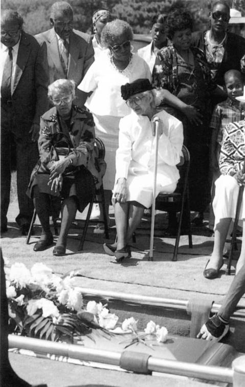 Ruby Young, center, watches as her husband, Earnest, 92, is buried July 19, 1995. His death in their Grand Boulevard neighborhood home was attributed to the heat wave.