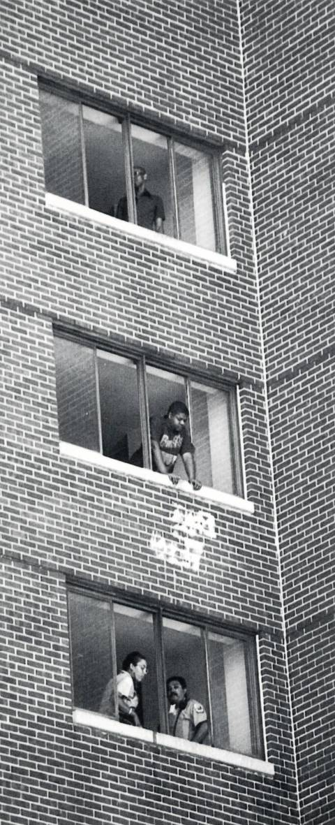 A resident of a CHA building at 4218 S. Cottage Grove Ave., waits for a emergency vehicle July 18, 1995, during Chicago's heat wave.