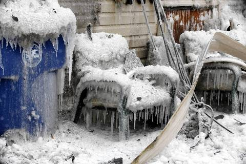 Household items are covered in ice at the scene of a fire in Cicero on Jan. 22, 2014.