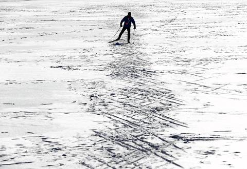 Roger Prevot, 54, skis through Grant Park's Hutchinson Field during his lunch hour Jan. 29, 2014, in preparation for a February cross-country race in Wisconsin.