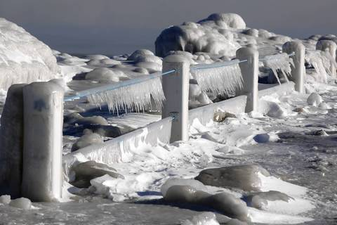 Ice covers a breakwall on Lake Michigan at 39th Street in Chicago as the temperature hits minus 3 degrees in late January 2014.