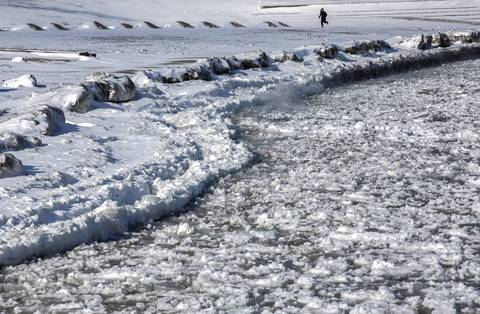 Chunks of ice float on Lake Michigan near the 31st Street Harbor in January 2014.