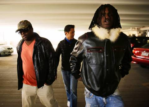 Keith Cozart, right, also knows as the rapper Chief Keef, exits the Lake County Courthouse in Waukegan with friends Friday after being arraigned for a DUI arrest.