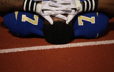 A Phoebus High School football player prepares for a game at Darling Stadium in Hampton, Va.