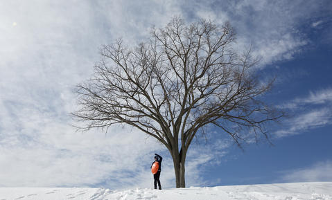 A sledder perches at the top of a hill inside Fort Monroe on Tuesday afternoon.
