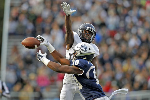 Old Dominion University's David Washington can't hang onto the ball while Florida International University's Wilkenson Myrtil defends during Saturday's game at Ballard Stadium.