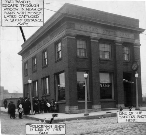 The Cicero State Bank, which was successfully defended against bandits the day before in 1921. The photo includes the original handwritten captions explaining where a bandit and police officer were shot and where two other bandits escaped.
