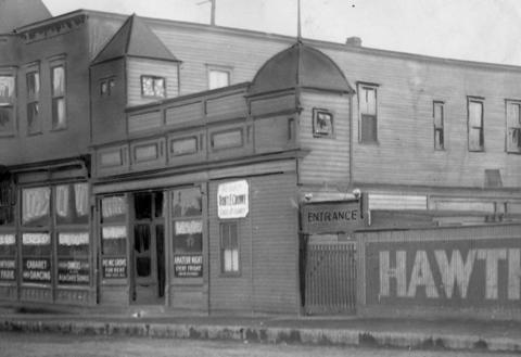 """A tavern owned by Eddie Tancl, located at 48th and Ogden avenues in 1924. The original caption says,""""It is open all hours and serves any kind of intoxicating liquor asked for without any pretense of secrecy being made."""""""