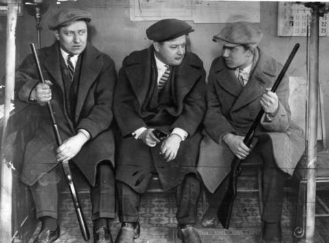 Three Cicero residents guard a candidate's headquarters against mobsters during the 1924 election.