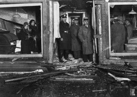 Police investigate the ruin caused by a bomb that went off in the office of the Suburban Leader newspaper in 1929. Police said the bomb was intended for the garage next door.